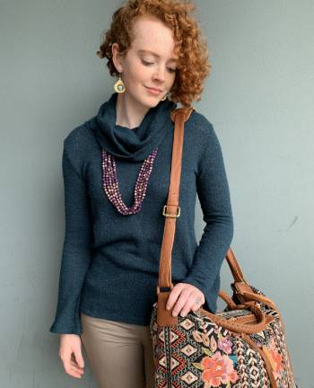 model wearing Blue Canoe Organic Clothing with a shoulder bag