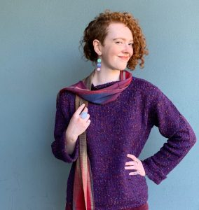 model in a purple sweater from Habbit Clothing